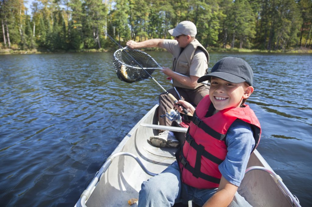 Boy and Father Fishing in a Canoe